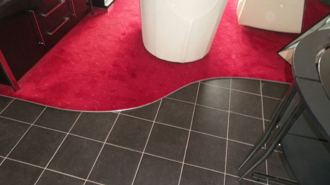 Black Onyx tile flooring & bespoke curved edging (2).JPG