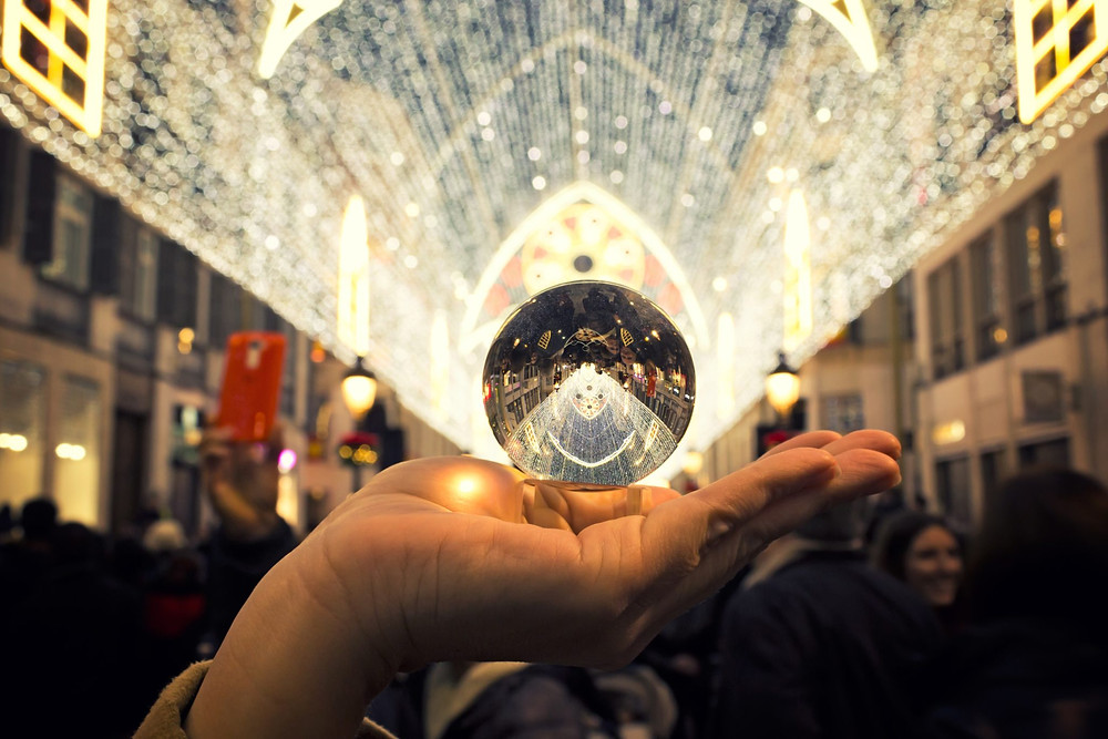 someone holding a crystal ball up to the light