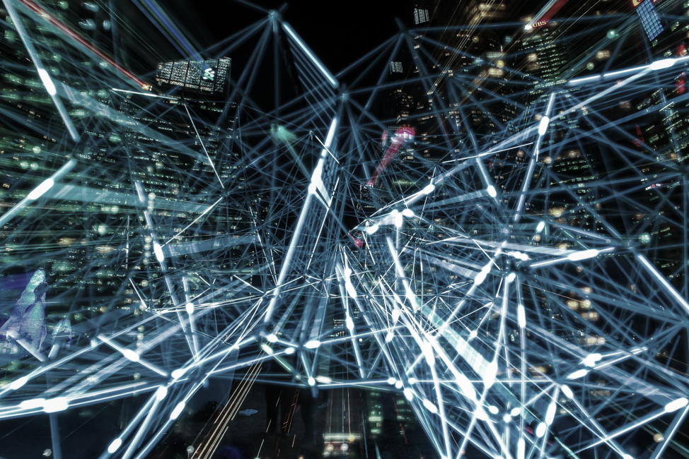data web in front of a city skyline
