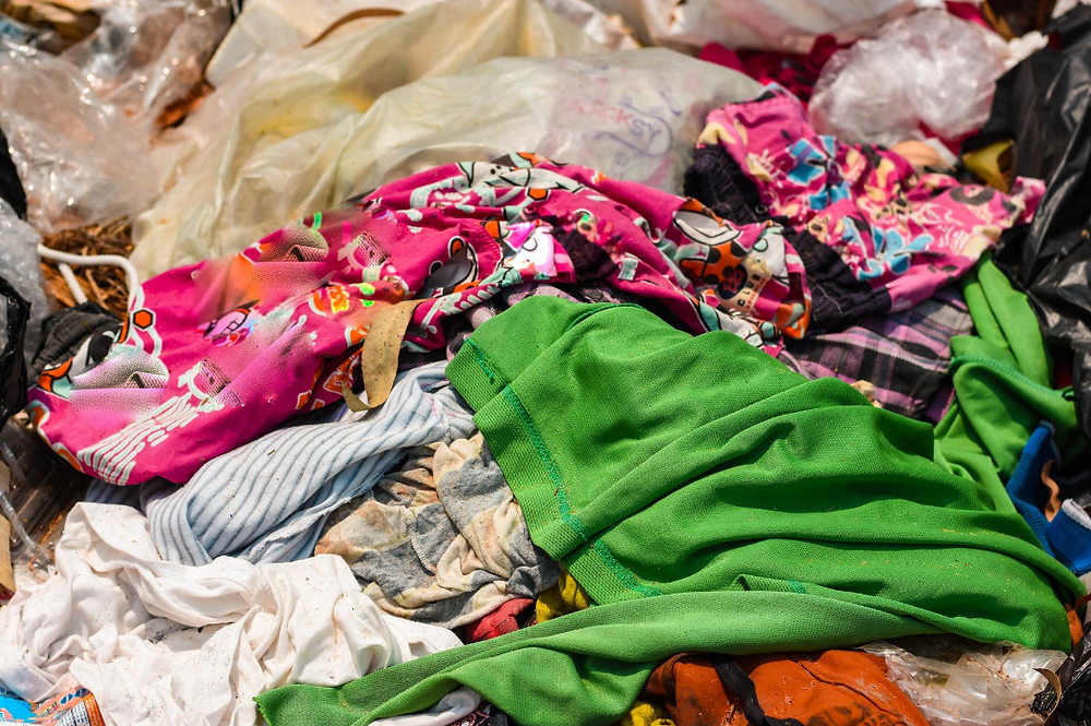 old clothing in a landfill