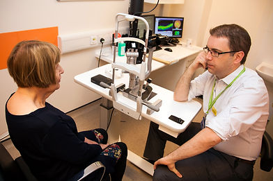 Dr Pearse Keane consulting with a patient at Moorfields