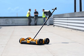 dec-scanner-side-shot-on-roof-with-peopl