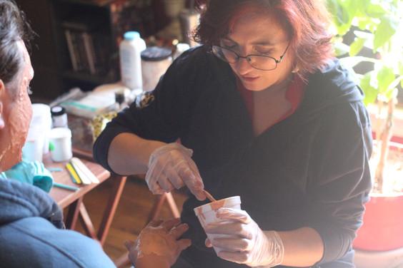 Erica applying Henrys makeup -Photo by E