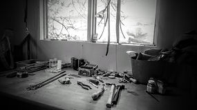 Leather workshop bench with tools