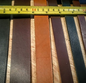 Straps of leather being measured