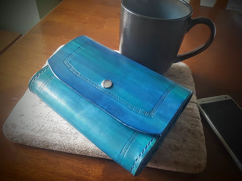 Natural veg tanned leather handcrafted clutch purse with strap hand stitched