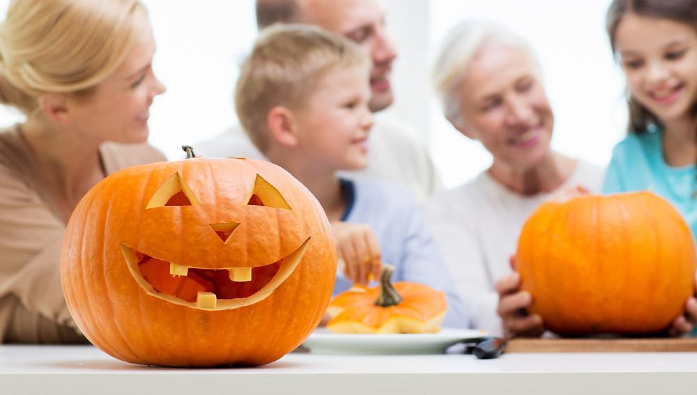 Family carving pumpkins at Halloween