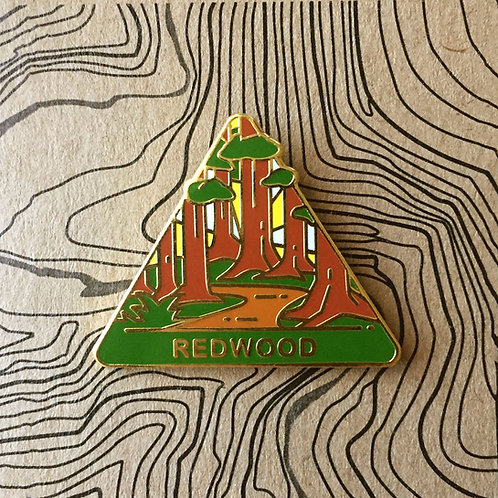 Triangle Redwood National Park Hard Enamel Pin featuring a trail winding through Redwood trees.