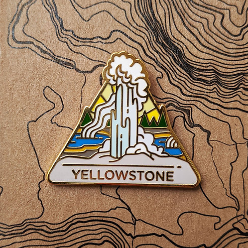 Triangle Yellowstone National Park Hard Enamel Pin featuring the famous Old Faithful geyser erupting and hot springs.