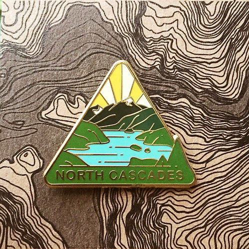 Triangle North Cascades National Park Hard Enamel Pin featuring the view of Diablo Lake's emerald waters.