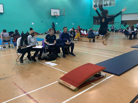 Sports leaders help to judge Primary Gymnastics competition