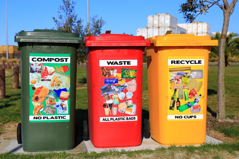 Three waste bin receptacles