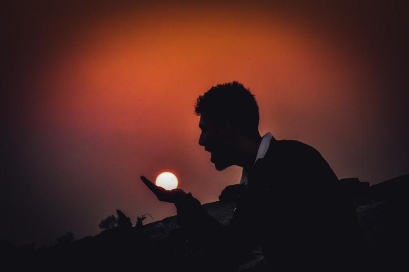 Man eating the sun