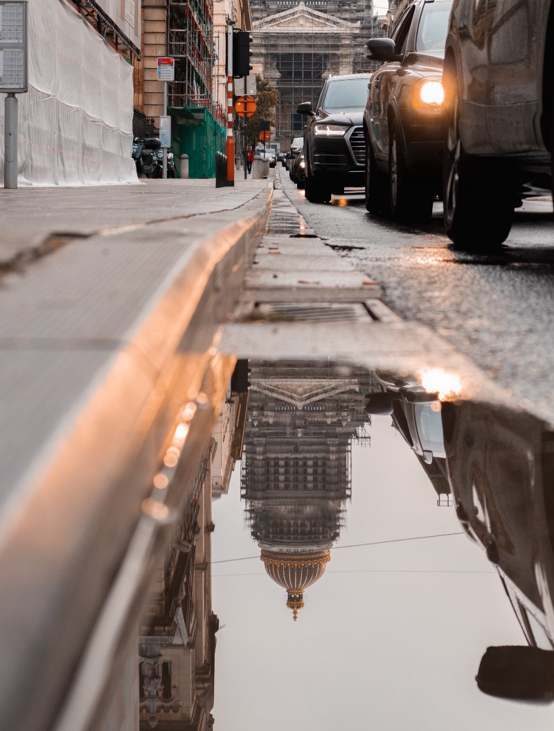 Reflection of Capital Building in Street Water