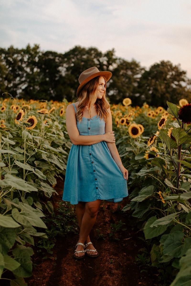 Environmentalist alone in sunflower field