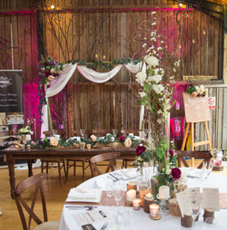 rustic wedding arch and top table