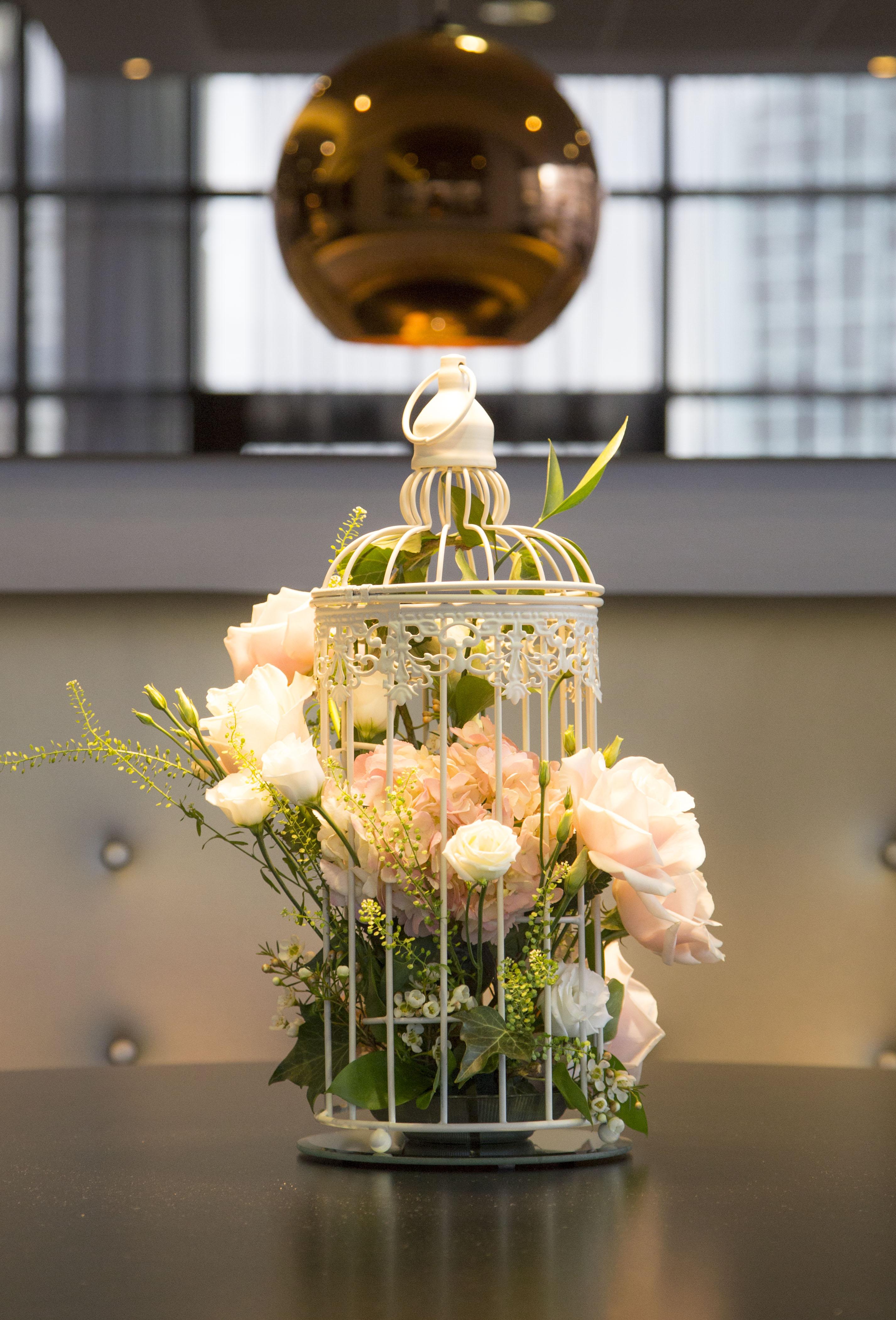 floral birdcage arrangement