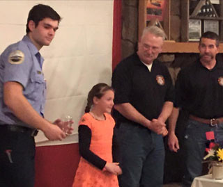 Leukemia survivor Holly Davis presented awards to Cloverdale firefighters who participated in the Scott Firefighter Stair Climb.Photo provided