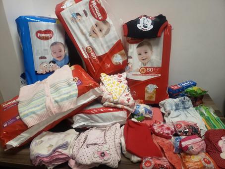 AKA retribui ajuda de projeto e realiza doação de fraldas e roupas de recém nascidos