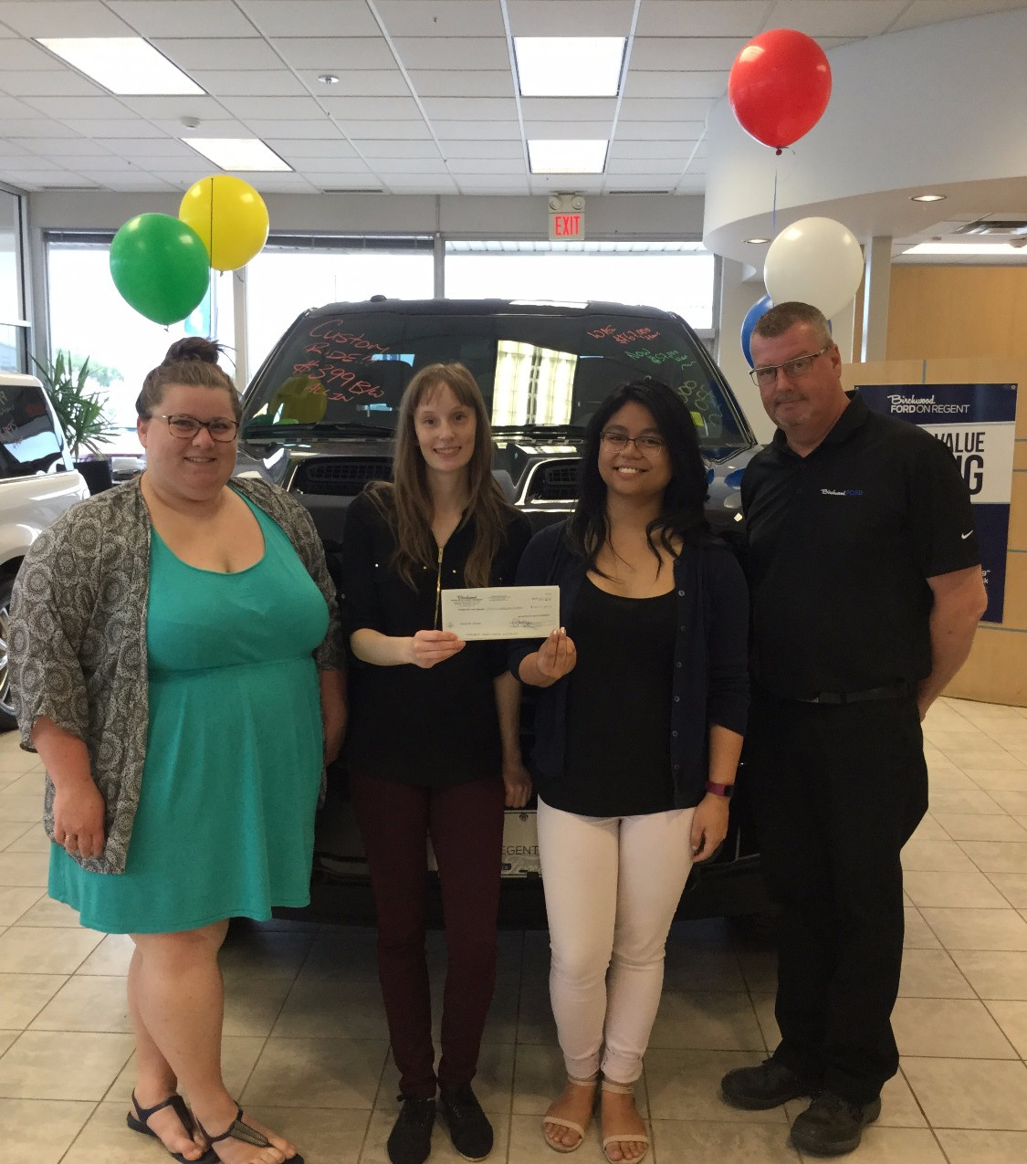 Summer Programming Assistants Tiffany Lepla and Janelle Linsangan with Jim Dolphin and Birchwood Ford staff member