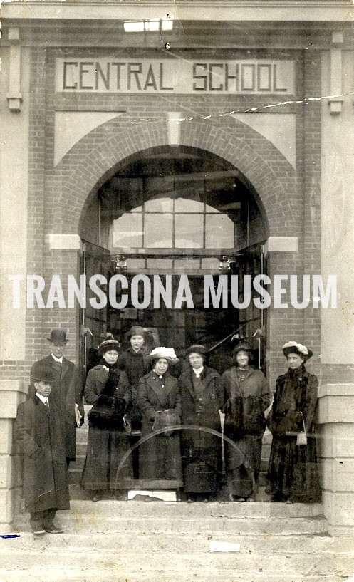 Left to right: Mr. Baxter, Dr. MacKay, May Baldwin, Sadie Baldwin, Miss Harriete Comrie, Millie Webster, Ethel Baldwin, Mrs. Crossland