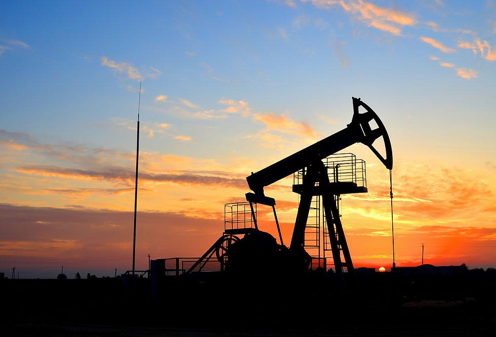 Oil drilling derricks at desert oilfield