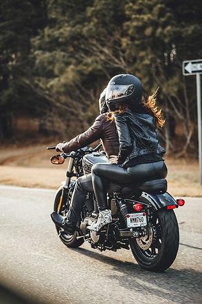 man & woman riding bike.jpeg