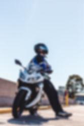 parked motorcycle_man next to bike.jpeg