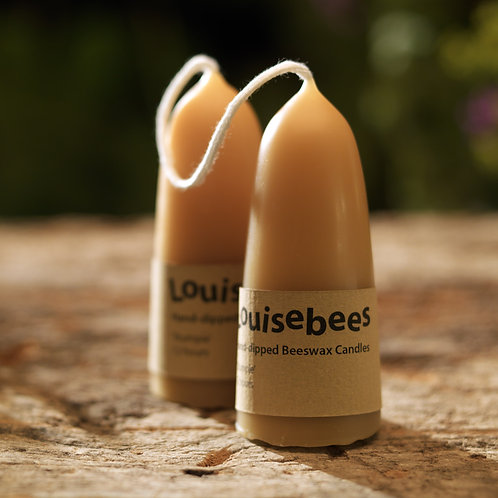 A pair of Hand-Dipped Stumpie Beeswax Candles