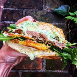 Steak, plantain, jack cheese, arugula Cuban sandwich with cilantro-lime aoli.