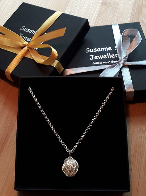 St.silver necklace with large wire ball charm