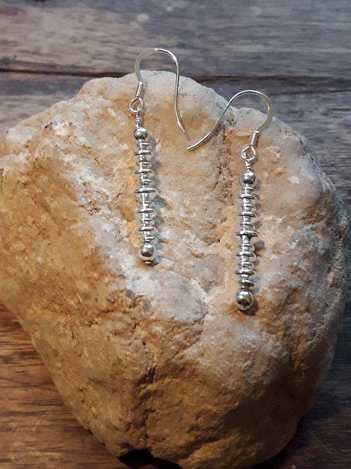 St.silver earring with saucer beads