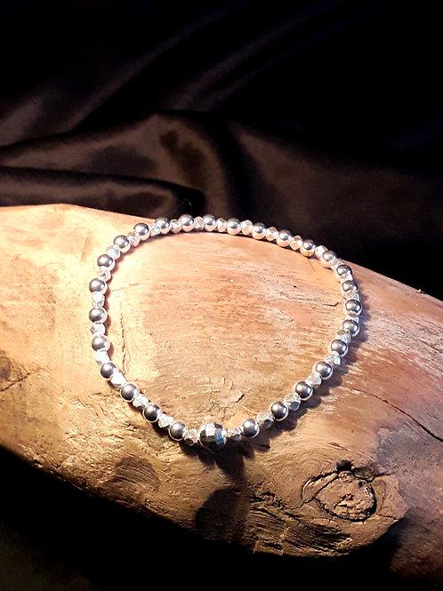 St.silver bead bracelet with diamond cut beads