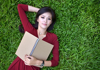 woman on grass with book Anankkml  Dream