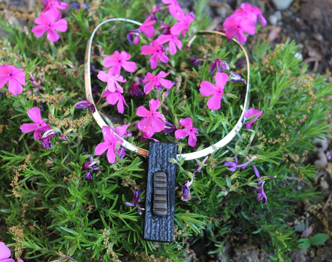 Bog oak with Irish stone inlay on sterling silver torc