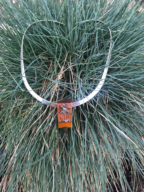 Ancient Kauri wood, flower made from little stone pieces, inlay of copper & yellow jacket acrylic on sterling silver torc