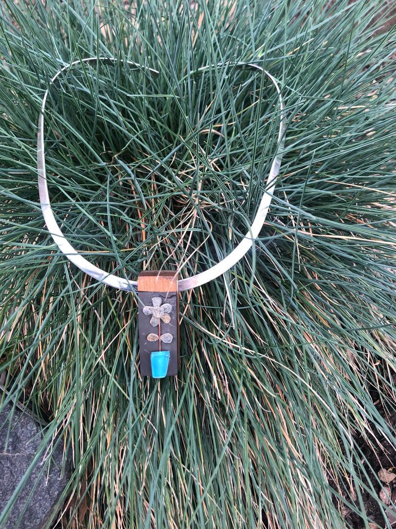 Created with twenty thousand year old kauri wood, New England reclaimed slate and Irish stone flower in blue glass pot