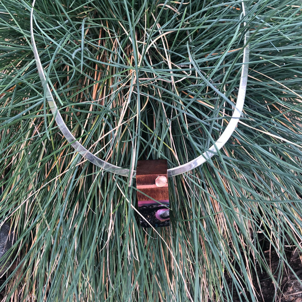Ancient Kauri wood and acrylic inlayed with copper and shell moon for a cosmic feel on sterling silver torc