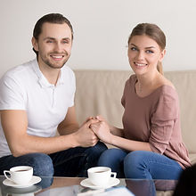 cheerful-young-family-couple-consultatio