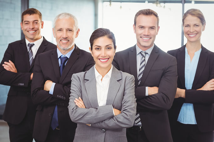 Portrait of businesspeople standing with