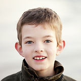 bigstock-young-boy-smiling-closeup-fac-1