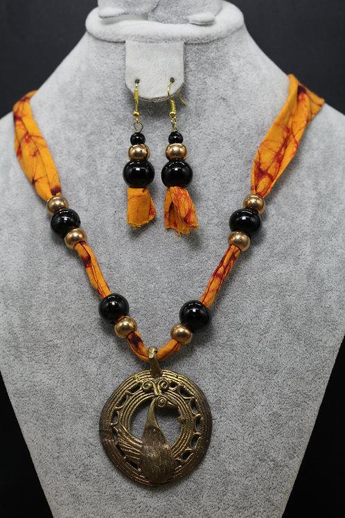 Dokhra pendant with batik cloth thread.