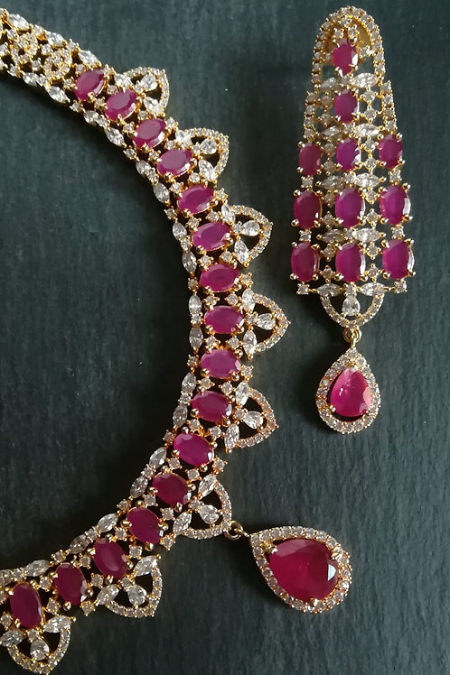 CZ necklace with pink stones.