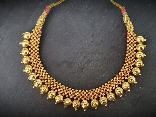 Golden bead Thushi