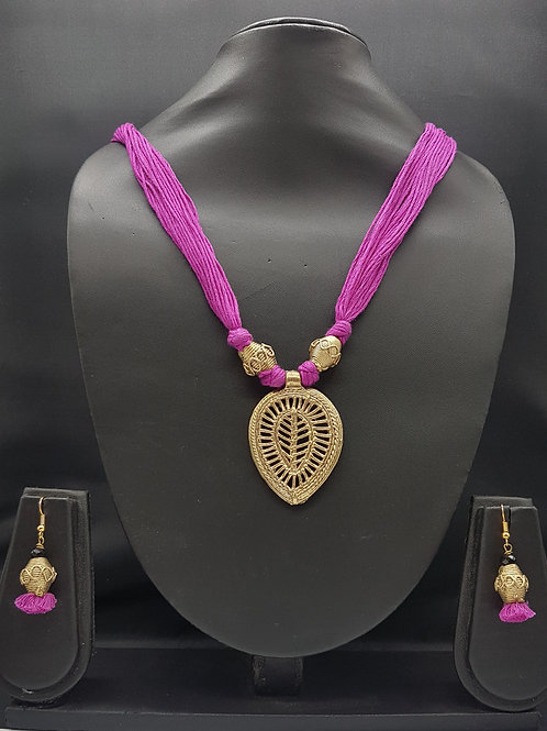 Dokhra pendant with purple textile thread with matching earrings.