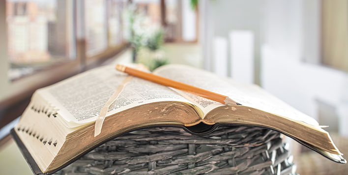 book-bible-with-pencil-close-up-backgrou