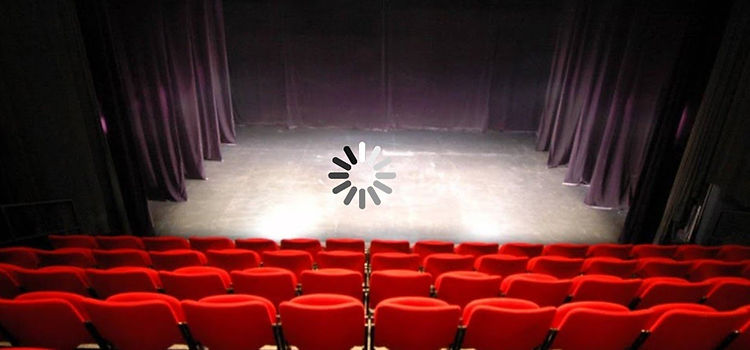 An empty stage with a waiting spinner