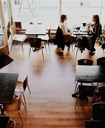 Women having coffee in empty coffee shop