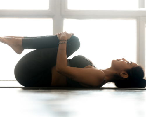 The Knee To Chest Stretch is a great stretch that is often used in both physical therapy and in yoga classes.