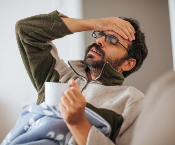 Man having to take time off work for back pain.